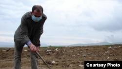 Armenia -- Journalist EdiK Baghdasaryan investigates the chemical waste disposal site in Nubarashen, Yerevan, undated