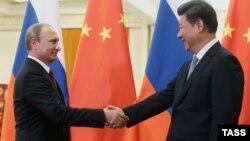 Президент России Владимир Путин и глава КНР Си Цзиньпин, архивное фото