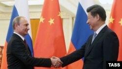 Президент Росії Володимир Путін і голова КНР Сі Цзіньпін, архівне фото