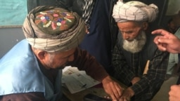 Elderly Afghans voting in the parliamentary elections in Kabul on October 20, 2018.