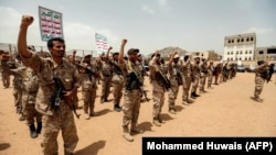 Huthi fighters in Yemen chant slogans as they take part in a gathering in the capital, Sanaa, in July.