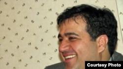 Jailed Iranian journalist Mehdi Mahmoudian