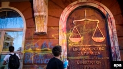 "Protesters in Macedonia's ""colorful revolution"" have spray-painted government buildings to demand a clean sweep of the government."