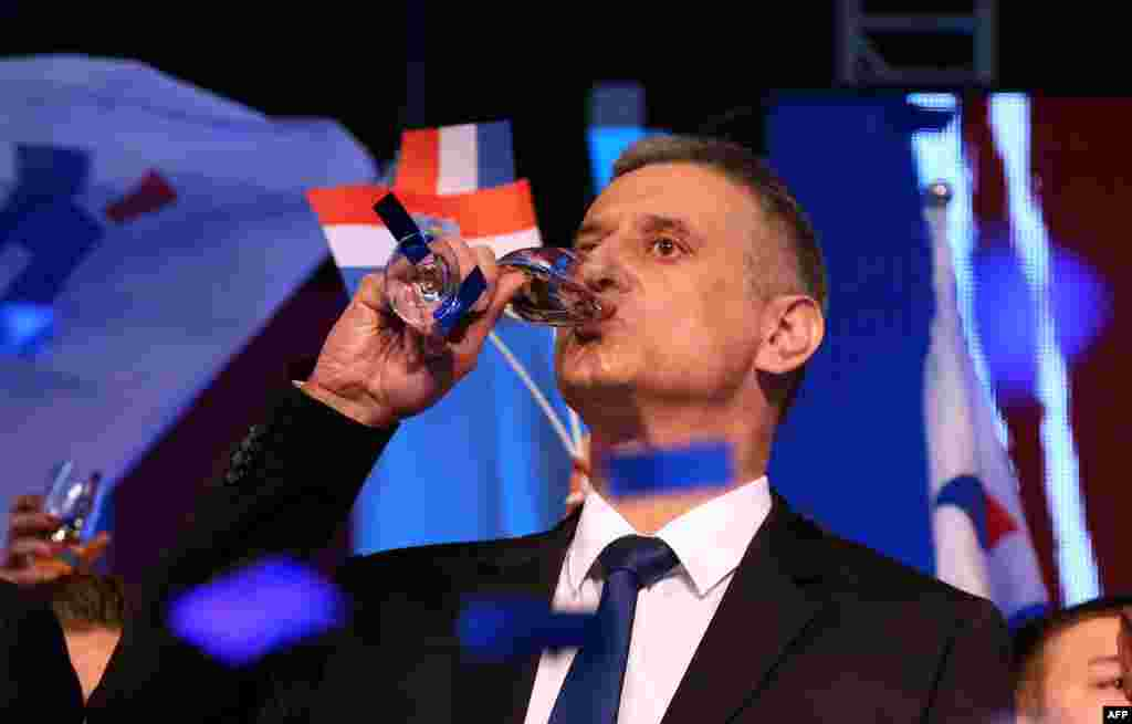 The leader of the conservative opposition Croatian Democratic Union party, Tomislav Karamarko, celebrates initial results of general elections in Zagreb. Croatia's conservative opposition was leading the vote count after a general election dominated by concerns over the migrant crisis and a sluggish economy. (AFP)
