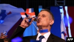 The leader of the conservative opposition Croatian Democratic Union party, Tomislav Karamarko, celebrates initial results.