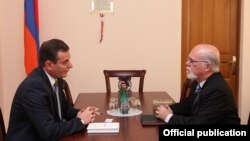 Armenia - Artak Zakarian (L), the chairman of the Armenian parliament's committee on foreign affairs, meets with Israel's ambassador to Armenia, Shmuel Meirom, in Yerevan, 21Aug2013.