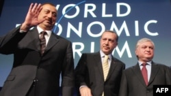 Azerbaijani President Ilham Aliyev (left) with Turkish Prime Minister Recep Tayyip Erdogan and Armenian Foreign Minister Edward Nalbandian in Davos earlier this year