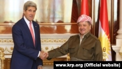 Kurdish leader Masud Barzani (right) meets with U.S. Secretary of State John Kerry in Irbil on June 24.