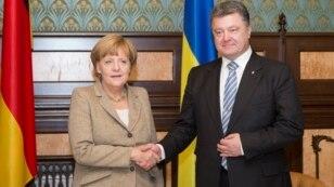 Merkel Donbasın bərpası üçün pul vəd etdi