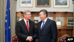 The European Union's enlargement commissioner, Stefan Fuele (left), pictured here with President Viktor Yanukovych in September.