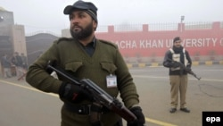Pakistani security officials stand guard outside Bacha Khan University, in Charsadda, on January 25.