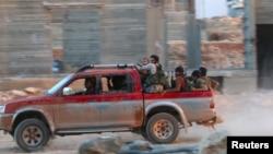 گروهی از جنگجویان وابسته به جبهه النصره در سوریه