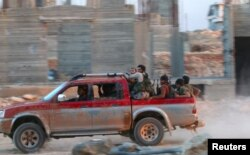 Fighters from Jabhat Fateh al-Sham in southwestern Aleppo on August 5