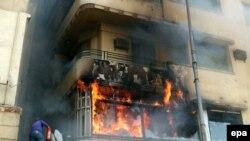 النار تشتعل في مكتب الجزيرة في القاهرة في ت2، 2012