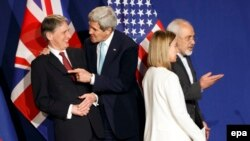 Switzerland -- (L-R) British Foreign Secretary Philip Hammond, US Secretary of State John Kerry, EU foreign policy chief Federica Mogherini and Iranian Foreign Minister Mohammad Javad Zarif, react during a press event after the end of a new round of Nucle