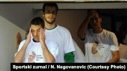 Igrači Partizana u majicama sa likom Aleksandra Stankovića