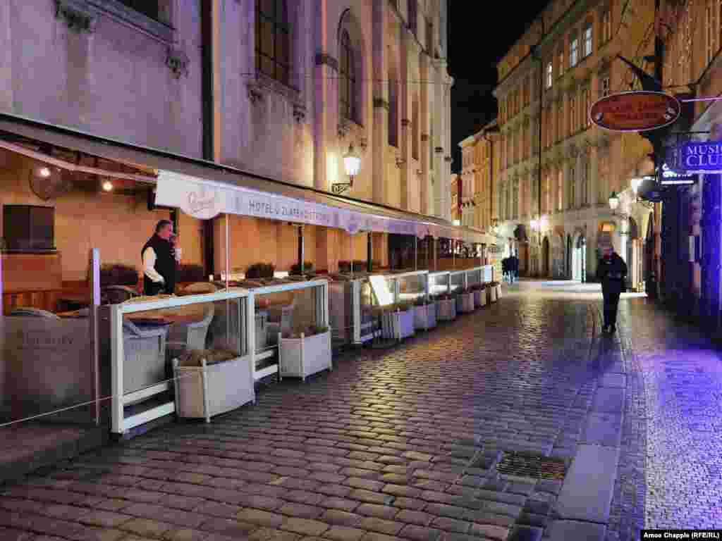 An outdoor restaurant in one of the busiest lanes in Prague's Old Town, after shutting down at 8 p.m.