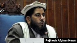 Fazal Hadi Muslimyar addresses senators after his election as Senate chairman in Kabul on March 11.
