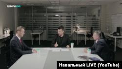 Олексій Навальний (л) і Ігор Гіркін (Стрєлков) (п) під час дебатів, Москва, відеокадр 20 липня 2017 року