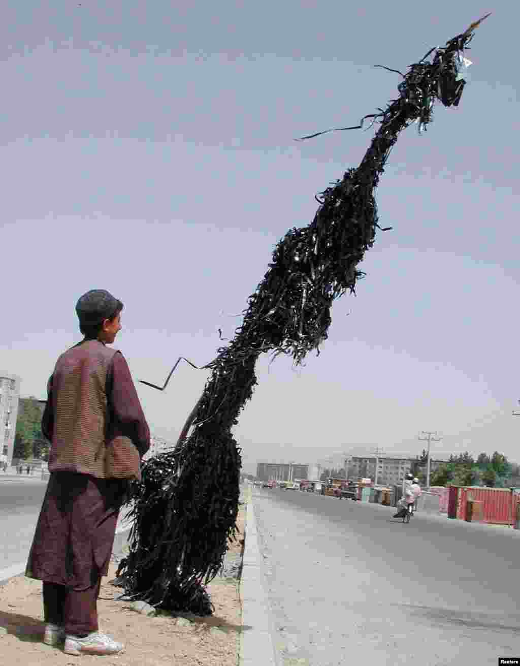 Music and movies were banned by the Taliban. This pole in Kabul is strung with tape stripped from destroyed cassettes.