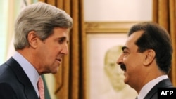Pakistan's Prime Minister Yousuf Raza Gilani (right) shakes hands with U.S. Senator John Kerry in Islamabad before their talks today.