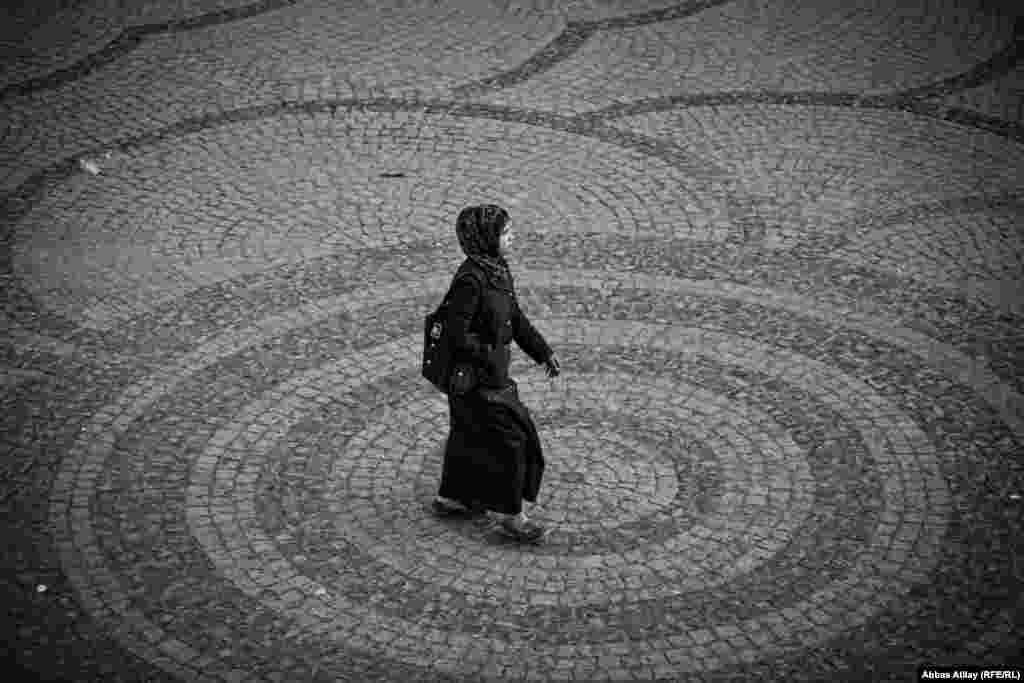 A woman walks through a city square in Irbil. Atilay notes that women in the Kurdish region seem to enjoy greater freedom of movement and dress than in many parts of Iraq.