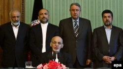 Standing behind Afghan President Ashraf Ghani, intelligence chief Rahmatullah Nabil and acting Defense Minister Masoon Stanekzai are part of the delegation going to Pakistan.