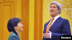South Korea President Park Geun-Hye (left) meets with U.S. Secretary of State John Kerry at the presidential Blue House in Seoul.