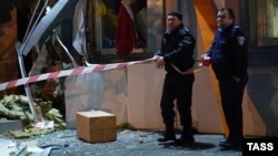 Police officers examine the site of an explosion at a building where an office collecting assistance for the Ukrainian military is based in Odesa last month. This incident was just one of many bombings across Ukraine in recent weeks.