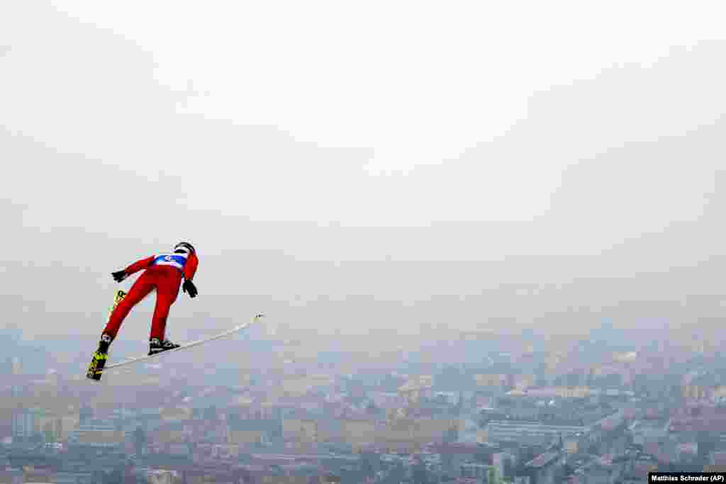 Russia's Viacheslav Barkov soars through the air during the ski-jumping portion of the Nordic Combined at the Nordic Ski World Championships in Innsbruck, Austria. (AP/Matthias Schrader)