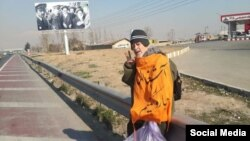 IRAN -- Dissident Mohammad Maleki engaging in a protest action by picking up trash.