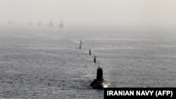 A handout photo made available by the Iranian Navy office on February 23, 2019, shows Iranian Navy submarines sailing during an Iranian navy drill in the Gulf of Oman, on February 22.