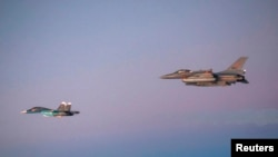 Russian Air Force fighter being escorted by a Norwegian Air Force jet on October 31, 2014.