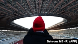 Национальный стадион в Токио был достроен в конце 2019 года специально для Олимпийских игр. Тогда в Японии еще не знали, что Игры придется отложить из-за пандемии коронавируса. Токио, 15 декабря 2019 года.
