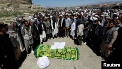Relatives take part in a burial ceremony of one of the victims of the blast in Kabul on June 1.