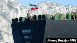 An Iranian flag flutters on board the Adrian Darya oil tanker, formerly known as Grace 1, off the coast of Gibraltar on August 18.