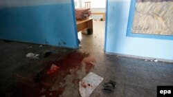 Кровь в здании школы ООН в секторе Газа после атаки израильтян, 24 июля 2014 года.