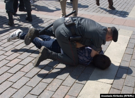 Russian security forces detain one of the participants in a gay-pride rally in Moscow on May 28.
