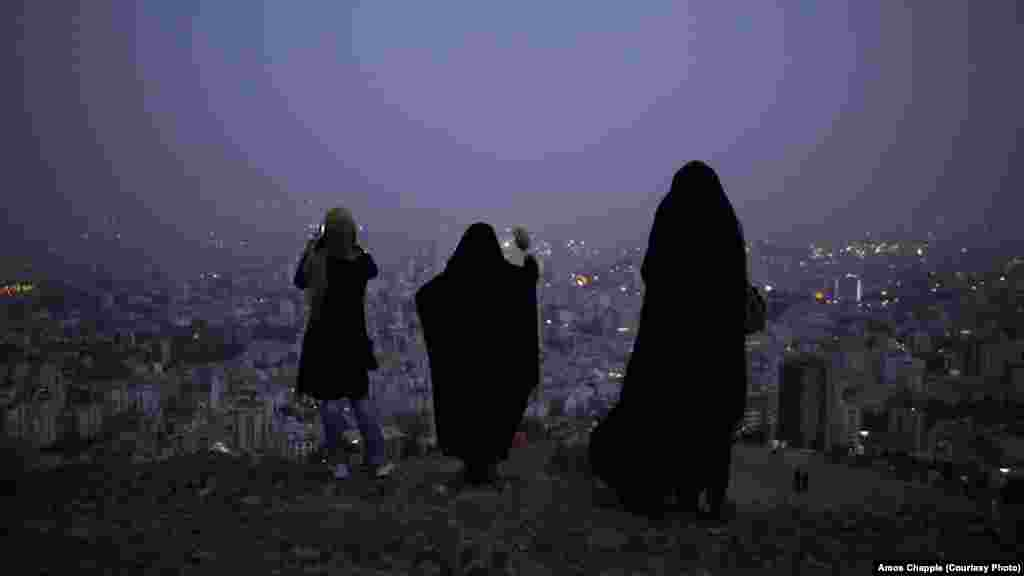 Women in the hills above Tehran at dusk