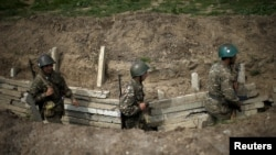 Nagorno-Karabakh -- Ethnic Armenian soldiers walk in a trench at an artillery positions near the Nagorno-Karabakh's town of Martuni, April 7, 2016