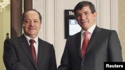 Стамбул: глава МИД Турции Ахмет Давутоглу (справа) и глава Курдского автономсного района в Ираке Масуд Барзани