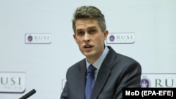 British Defense Secretary Gavin Williamson speaks at the Royal United Services Institute in London on February 11.