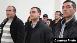 Armenia - Former soldiers Musa Serobian (L) Arayik Zalian (C) and Razmik Sargsian hear the announcement of a court verdict upholding their innocence in a high-profile murder case, Gyumri, 18Dec2012. (Photo courtesy of Asparez.am)