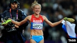 Yulia Zaripova shortly after crossing the line first in the 3,000-meter steeplechase final at the 2012 London Olympics.