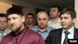 Chechen leader Ramzan Kadyrov at a June meeting with Ingushetia's acting President Rashid Gaysanov (right)