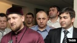 Chechen leader Ramzan Kadyrov at a June meeting with Ingushetia's acting President Rashid Gaysanov (right)