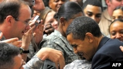 U.S. President Barack Obama greets troops during a visit to Camp Victory, just outside Baghdad, on April 7.
