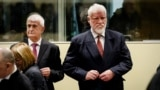 Former Bosnian Croat Defense Minister Bruno Stojic (left) and former General Slobodan Praljak wait in court prior to the judgement in their appeals case on November 29.