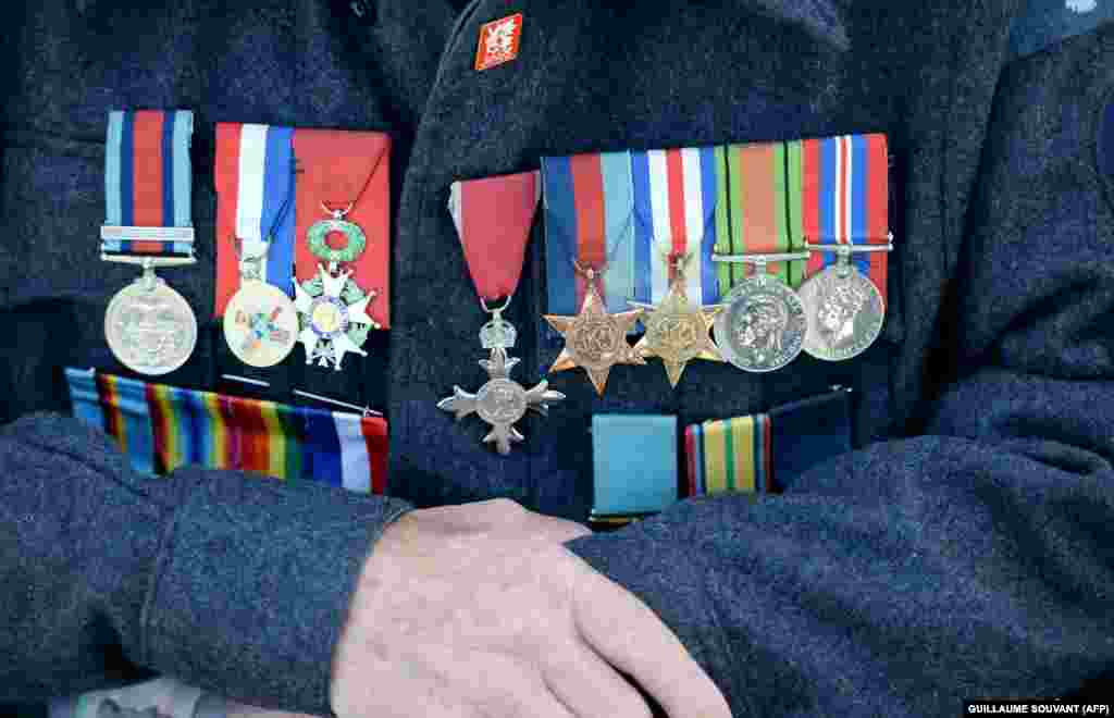 FRANCE -- Medals are pinned on the jacket of Canadian veteran Leon Teacher, 96, prior the international ceremony on Juno Beach in Courseulles-sur-Mer, Normandy, northwestern France, on June 6, 2019