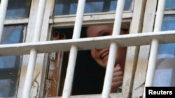 Yulia Tymoshenko is seen through a prison window in Kyiv in November.
